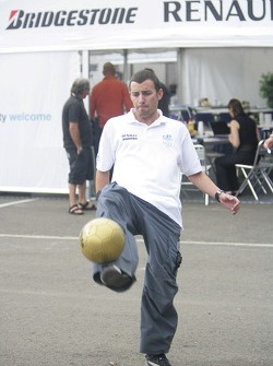 Will Buxton plays football in the paddock