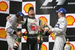 Podium: champagne for Jenson Button, Pedro de la Rosa and Nick Heidfeld