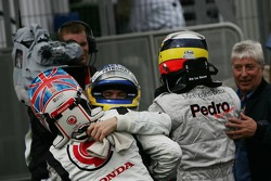 Race winner Jenson Button celebrates with Pedro de la Rosa and Nick Heidfeld
