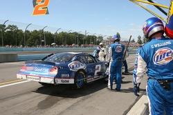 Miller Lite Dodge crew members work on the car of Kurt Busch