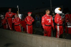 Chip Ganassi crew members watch the last lap