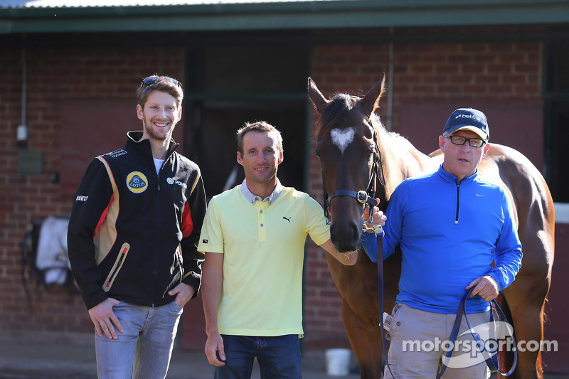 Romain Grosjean, Lotus F1 Team, meets Lankan Rupee, the world's fastest horse, with Champion trainer Mick Price, and jockey Damien Oliver