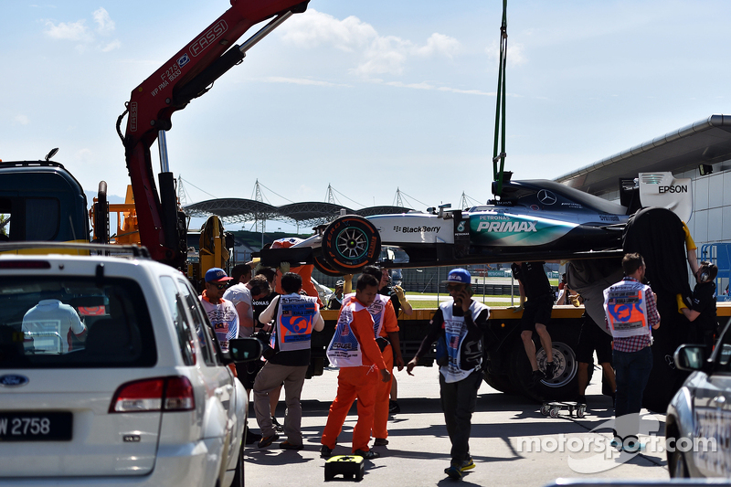 Mercedes AMG F1 W06 of Lewis Hamilton, Mercedes AMG F1 is recovered back to pits on back of a truck