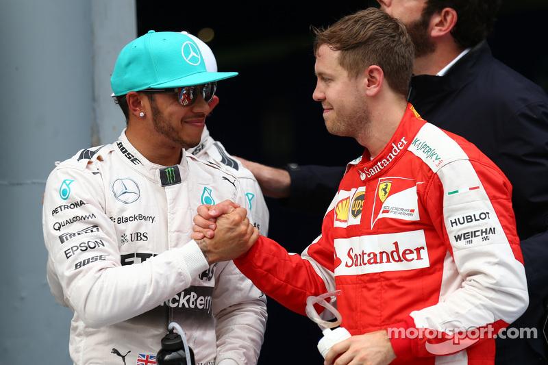 Lewis Hamilton, Mercedes AMG F1, dan Sebastian Vettel, Ferrari SF15-T