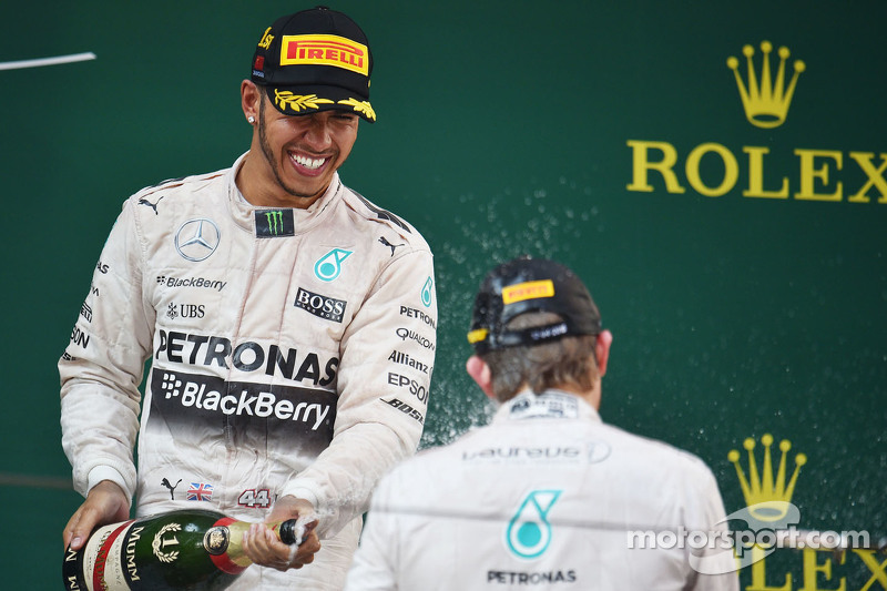 Race winner Lewis Hamilton Mercedes AMG F1 celebrates with the champagne on the podium with second p