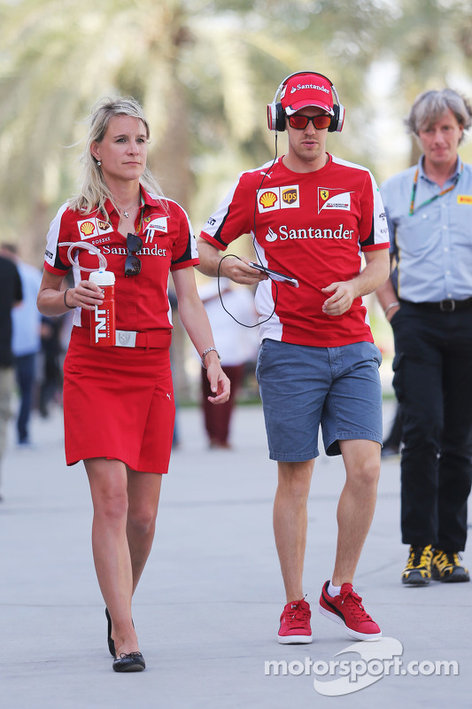 f1-bahrain-gp-2015-sebastian-vettel-and-britta-roeske-ferrari-press-officer.jpg