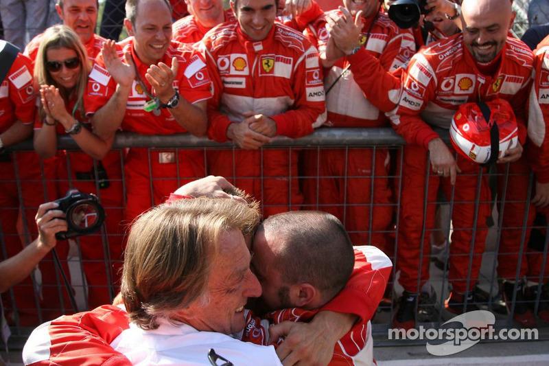 Race winner Michael Schumacher celebrates with Luca di Montezemolo