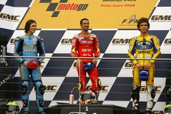 Podium: race winner Marco Melandri celebrates with Chris Vermeulen and Valentino Rossi