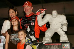 Race winner Jeff Burton poses for a photo and his wife Kim, daughter Paige and son Harrison