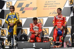 Podium: race winner Loris Capirossi with Valentino Rossi and Marco Melandri