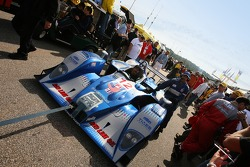 #12 Autocon Motorsports Lola EX257 AER makes its way to the grid in a dense crowd