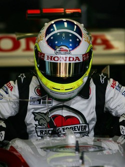 Rubens Barrichello with a new helmet design for this race