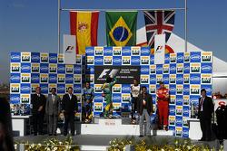 Podium: race winner Felipe Massa with 2006 World Champion Fernando Alonso and Jenson Button