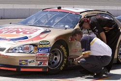 A Goodyear Tire Engineer check the pressure on Bill Elliott's car