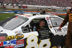 Dale Jarrett waits out the rain delay