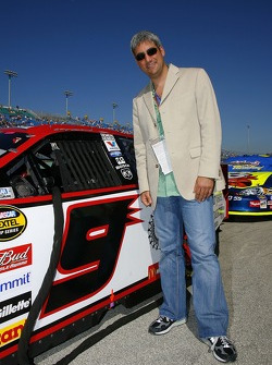 Taylor Hicks poses for a photo with the car of polesitter Kasey Kahne