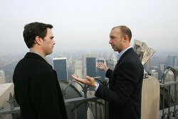 Jimmie Johnson, left, talks with Chad Knaus on the Top of the Rock Observation Deck at Rockefeller Center