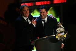 Comedian Jay Mohr jokes with Tony Stewart during the 2006 NASCAR NEXTEL Cup Series Awards Ceremony