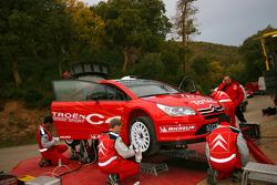Citroën team members work on the C4 WRC