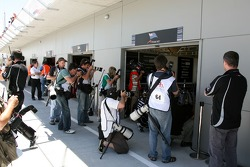 Photographers gather outside Team New Zealand waiting for Jonny Reid