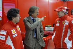 Luca Baldisserri, head of trackside operations and Luca di Montezemolo with Kimi Raikkonen