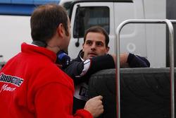 Bridgestone personnel talking to BMW-Sauber personnel