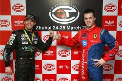 GT1 and overall pole winner Thomas Biagi and GT2 pole winner Dirk Muller celebrate