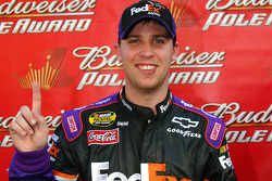 Pole winner Denny Hamlin celebrates