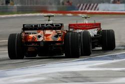 Adrian Sutil, Spyker F1 Team, F8-VII and Lewis Hamilton, McLaren Mercedes, MP4-22