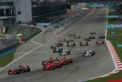 Start: Fernando Alonso, McLaren Mercedes, MP4-22, leads in front of Felipe Massa, Scuderia Ferrari, F2007, and Lewis Hamilton