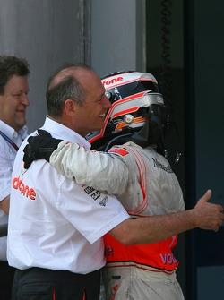 Race winner Fernando Alonso celebrates with Ron Dennis