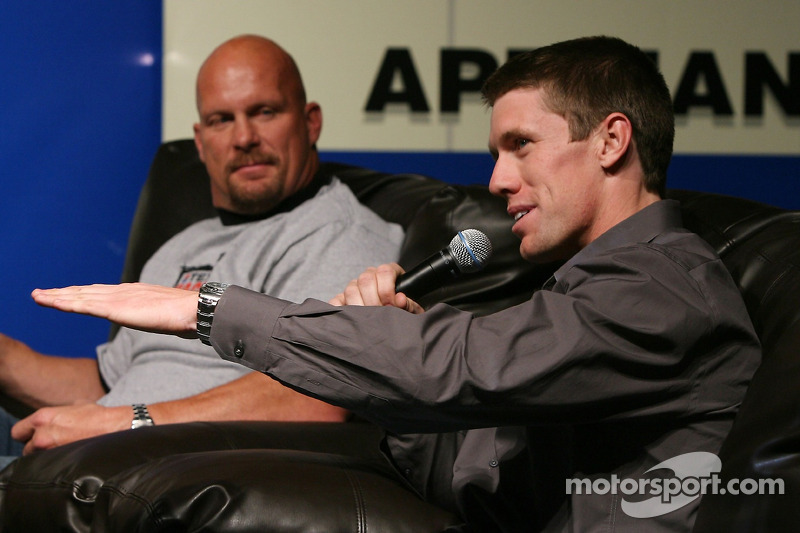 "Carl Edwards speaks to the fans as WWE wrestler ""Stone Cold"" Steve Austin looks on, during the ..."