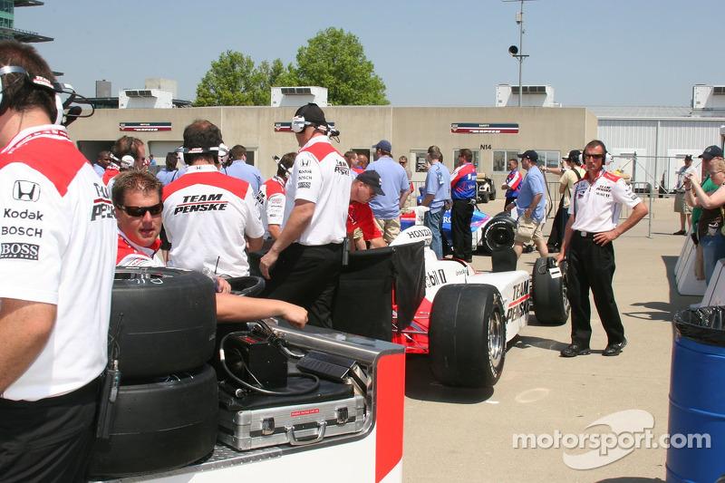 Team Penske cars wait for technical inspection
