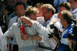 Mika Hakkinen, Team HWA AMG Mercedes, being congratulated by his manager Didier Cotton