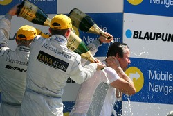 Podium: Gerhard Ungar, Chief Designer AMG, gets a champagne shower