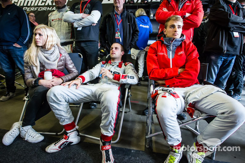 Laurens Vanthoor with his girlfriend Jacqueline, and Nico Müller watch the last few minutes of the race