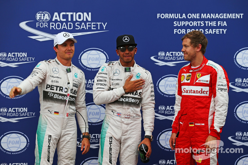 Nico Rosberg und Lewis Hamilton, Mercedes AMG F1, und Sebastian Vettel, Ferrari
