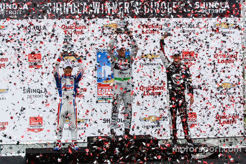 Podium: Race winner Sébastien Bourdais, second place Takuma Sato and third place Graham Rahal