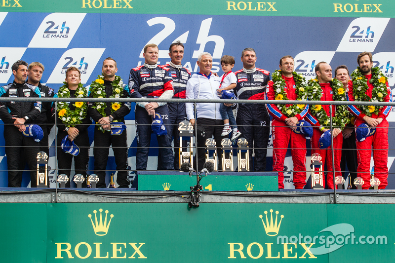 LMGT Am podium: class winners #72 SMP Racing Ferrari 458 GTE: Andrea Bertolini, Viktor Shaitar, Alexey Basov with SMP owner Boris Rotenberg, second place #77 Dempsey Proton Competition Porsche 911 RSR: Patrick Dempsey, Patrick Long, Marco Seefried, third