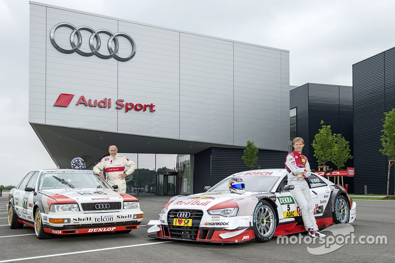 Hans-Joachim Stuck with Mattias Ekström celebrating a throwback livery celebrating Audi's debut DTM win from 1990 at the Norisring