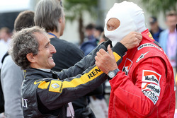 Alain Prost, and Niki Lauda, Mercedes Non-Executive Chairman at the Legends Parade