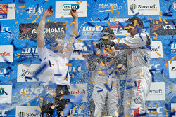 Podium: race winner Sébastien Loeb, second place Jose Maria Lopez, third place Yvan Muller