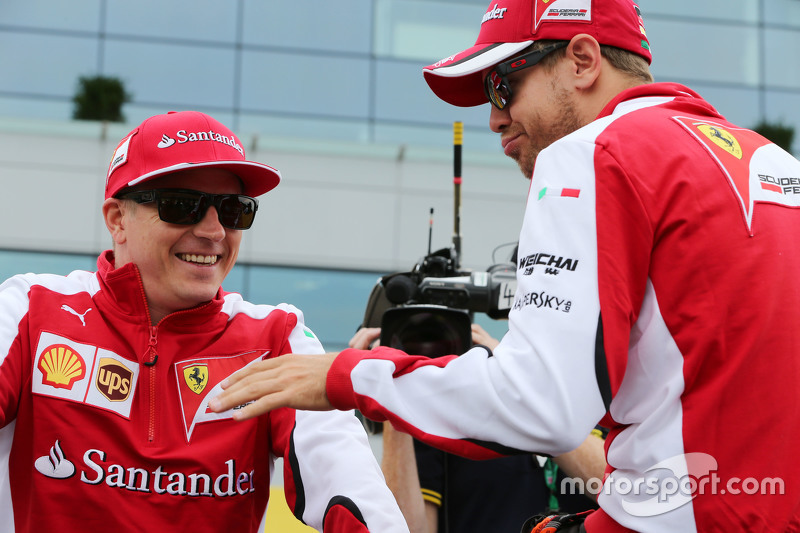 (L to R): Kimi Raikkonen, Ferrari with Sebastian Vettel, Ferrari on the drivers parade