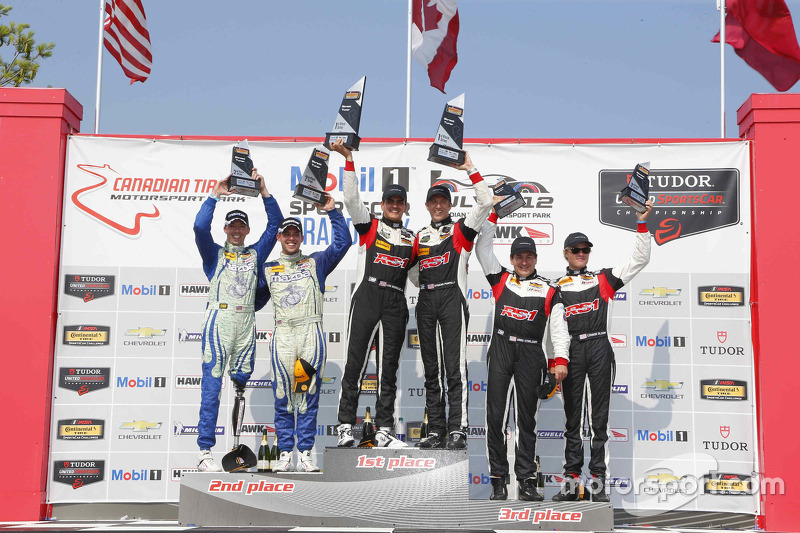 Podium: Race winners #17 RS1 Porsche Cayman: Spencer Pumpelly, Luis Rodriguez Jr., second place #26 Freedom Autosport Mazda MX-5: Andrew Carbonell, Liam Dwyer and third place #19 RS1 Porsche Cayman: Connor Bloum, Greg Strelzoff