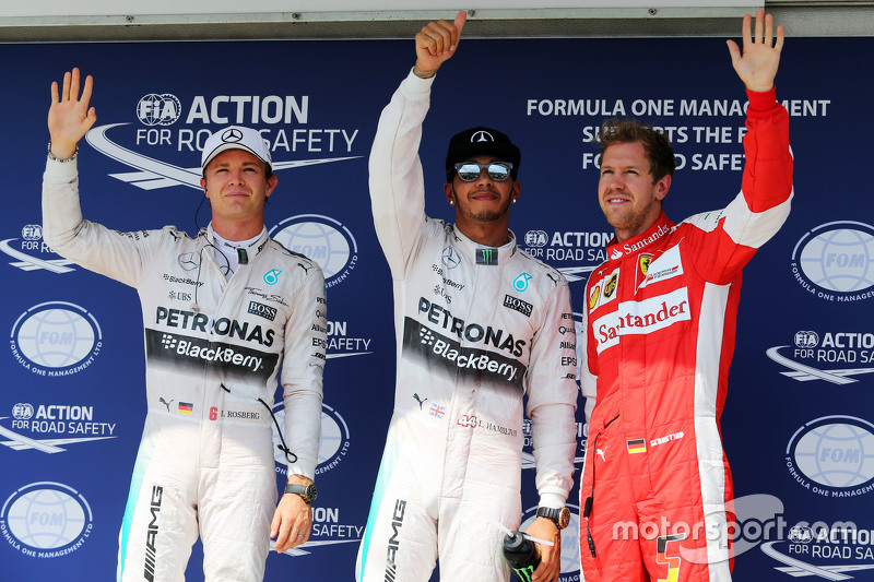 Qualifying top three in parc ferme,: Nico Rosberg, Mercedes AMG F1, second; Lewis Hamilton, Mercedes