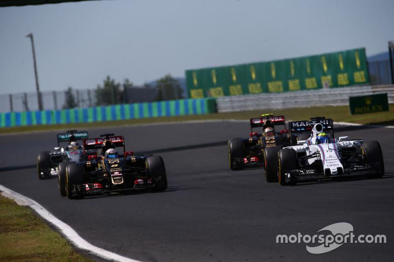 Romain Grosjean, Lotus F1 E23 and Felipe Massa, Williams FW38