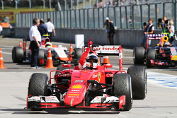 Race winner Sebastian Vettel, Ferrari SF15-T celebrates in parc ferme