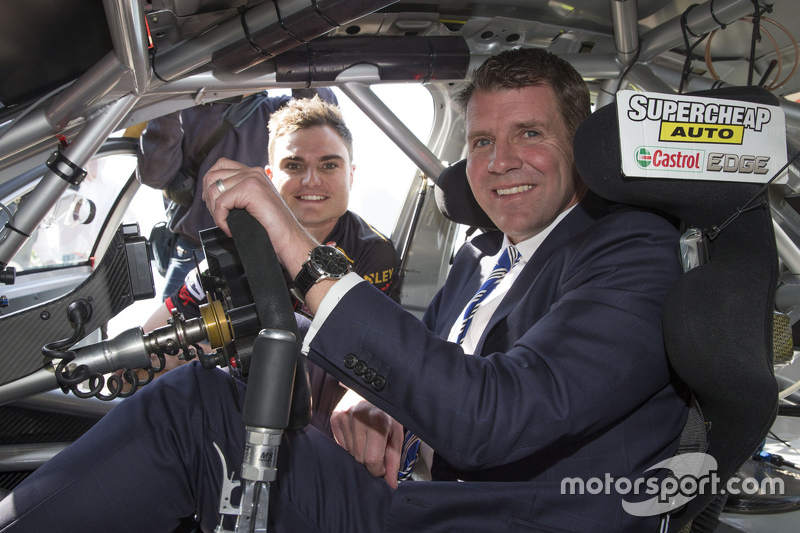 NSW Premier Mike Baird  climbs into V8 Supercar of Tim Slade
