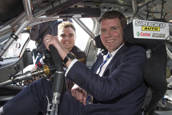 NSW Premier Mike Baird  climbs into V8 Supercar of Tim Slade