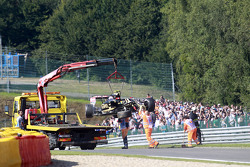 Lotus F1 E23 of Pastor Maldonado, Lotus F1 Team is recovered back to pits on back of a truck after h